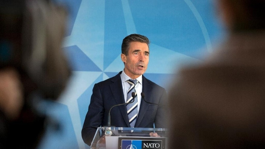 NATO Secretary General Anders Fogh Rasmussen speaks during a media conference at NATO headquarters in Brussels Sunday, March 2, 2014. NATO is calling emergency talks on Sunday regarding the escalating crisis in Ukraine. (AP Photo/Virginia Mayo)