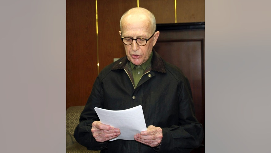 In this photo taken on Saturday, March 1, 2014, provided by the Korean Central News Agency, John Short, an Australian missionary detained for spreading Christianity in North Korea, reads his written apology, at an unknown location in North Korea.  North Korea said Monday, March 3, 2014, it will deport Short, saying he apologized for his anti-state religious acts and requested forgiveness. Authorities in North Korea have been investigating Short since his arrest for secretly spreading Bible tracts near a Buddhist temple in Pyongyang on Feb. 16, the birthday of late leader Kim Jong Il, the North's official Korean Central News Agency said. (AP Photo/Korean Central News Agency)