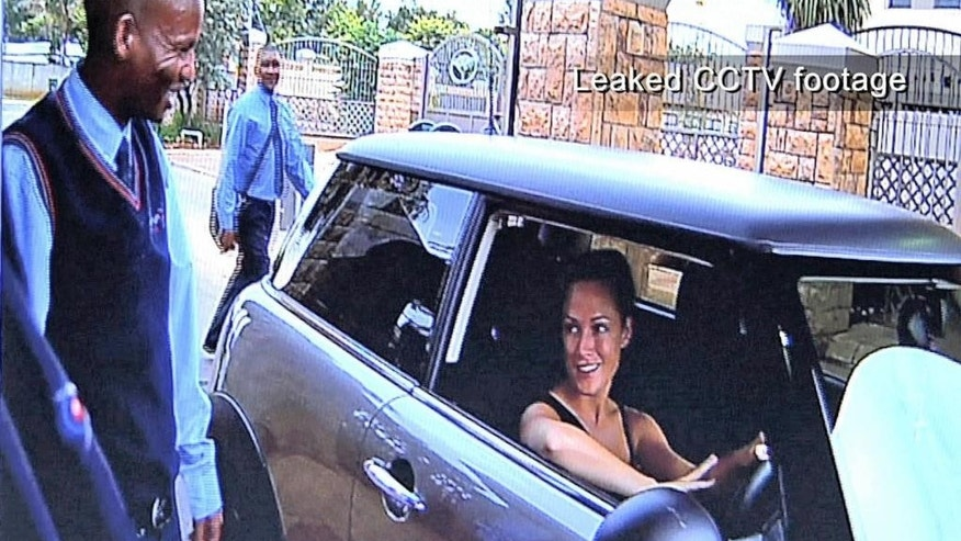 FILE - In this frame grab from CCTV footage leaked to M-Net's Carte Blanche program which viewed Sunday Feb 24, 2013, shows Reeva Steenkamp entering the secured access to the Silverwoods housing estate, home of Olympian athlete Oscar Pistorius,  some hours before she was shot and killed at Pistorius' home.  Ahead of Pistorius' trail, for the shooting death starting Monday, March 3, 2014, legal experts say Pistorius would still be vulnerable to a homIcide conviction even if he is acquitted of murdering Steenkamp. (AP Photo/M-Net Carte Blanche, File)
