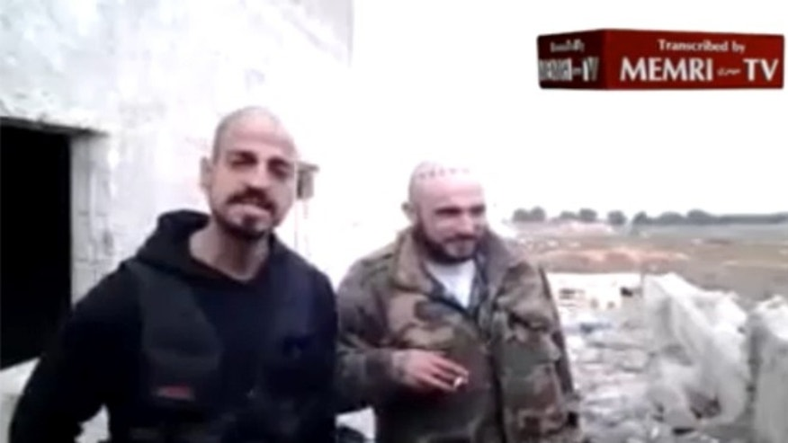 """Creeper,"" left, of the Surenos, a loosely-affiliated group with ties to the Mexican Mafia, is seen on the video with a man who calls himself ""Wino,"" of the Westside Armenian Power gang. Both men claim they're on the ""front lines"" of the ongoing fight in Syria. (MEMRI.org)"