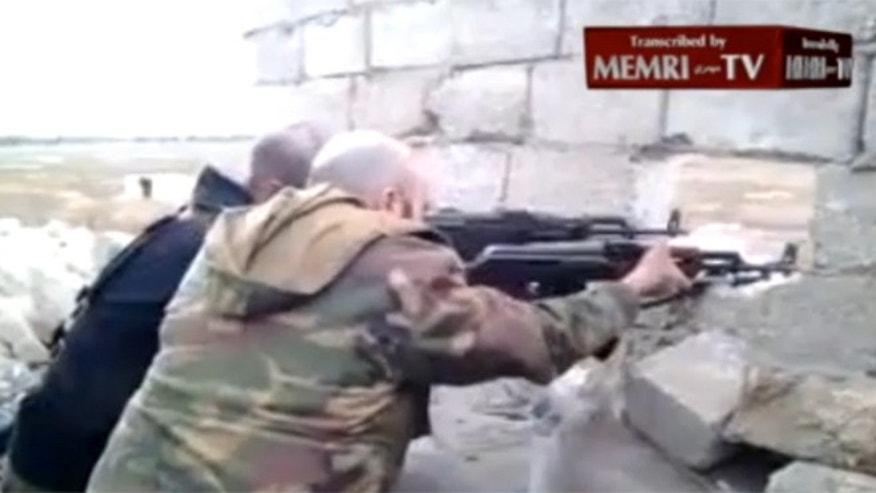 "Both men seen in the 2-minute video clip fire guns in the direction of enemies they call ""enemigos."" Experts told FoxNews.com they are likely mercenaries loyal to President Bashar al-Assad. (MEMRI.org)"