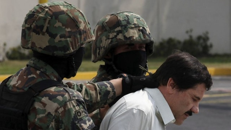 "FILE - In this Feb. 22, 2014, file photo, Joaquin ""El Chapo"" Guzman, in handcuffs, is escorted to a helicopter by Mexican navy marines in Mexico City, Mexico. (AP)"