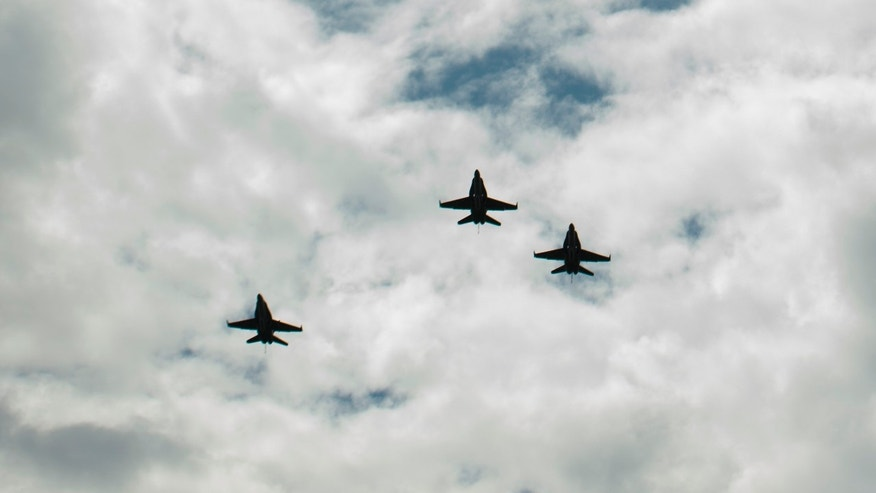 "CINCINNATI, OH - AUGUST 31:  In this handout photo provided by NASA, U.S. Navy F/A-18 jets from Strike Fighter Squadron (VFA) 106 and Strike Fighter Squadron (VFA) 34, from Naval Air Station Oceana (Va.) fly in a ""Missing Man"" formation over the Camargo Club following a memorial service celebrating the life of Neil Armstrong on August 31, 2012 in Cincinnati, Ohio. Armstrong, the first man to walk on the moon during the 1969 Apollo 11 mission, died Saturday, August 25. He was 82. (Photo by Bill Ingalls/NASA via Getty Images)"