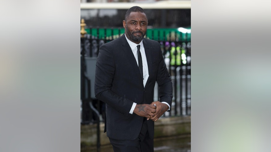 British actor Idris Elba who portrayed Nelson Mandela in a recent film arrives for the Nelson Mandela memorial service at Westminster Abbey in London Monday, March, 3, 2014.  Mandela the former president of South Africa died in December 2013. (AP Photo/Alastair Grant)