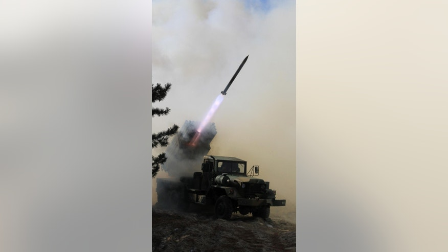 South Korean Army's 130mm multiple rocket launcher fires a live round during an exercise against possible attacks from North Korea in Goseong, South Korea, Monday, March 3, 2014. North Korea fired two additional suspected short-range missiles into the sea Monday amid ongoing military exercises between Seoul and Washington, which the North calls a preparation for an attack, South Korean officials said. (AP Photo/Yonhap, Lee Jong-gun) KOREA OUT