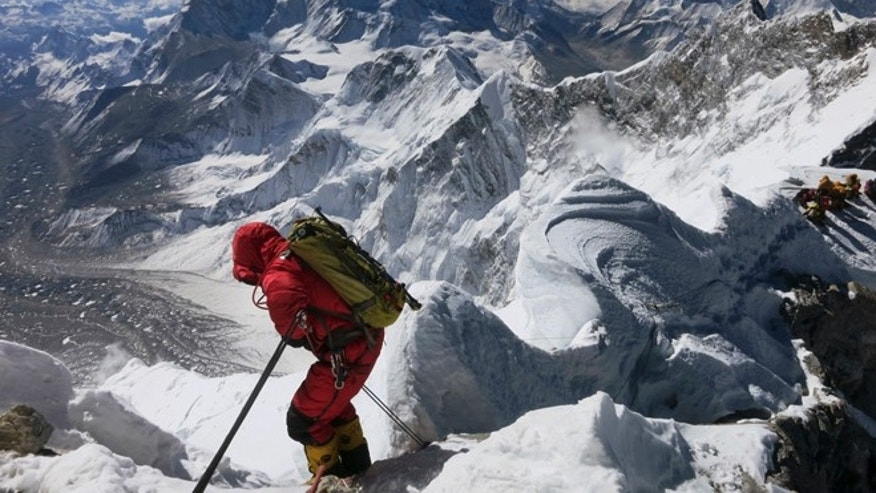 May 18, 2013: In this file photo released by Alpenglow Expeditions, a climber prepares to descend the Hillary Step as he makes his way down from the summit of Mount Everest, in the Khumbu region of the Nepal Himalayas. Nepal will slash the climbing fees for Mount Everest to attract more mountaineers to the world's highest peak, even as concerns grow about the environmental effects of thousands of climbers who already crowd the mountain during the high season.