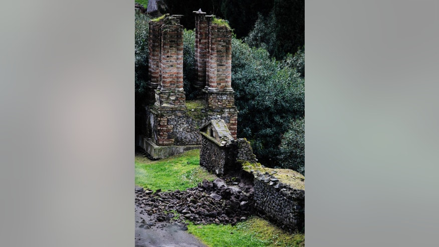 Bricks and rocks are seen on the ground after, according to Italian media, they collapsed from the Porta Nocera doorway, in the ancient Roman city of Pompeii, as a consequence of a rainstorm, Sunday, March 2, 2014. Top Italian culture officials are calling for swift action to save Pompeii, the ancient Roman city encased in volcanic ash, from further ruin after heavy rains, Saturday, March 1, reportedly caused part of a wall to collapse. Giancarlo Galan, the head of a parliamentary culture commission lamented the latest collapse at the archaeological site near Naples. (APhoto/Salvatore La Porta)
