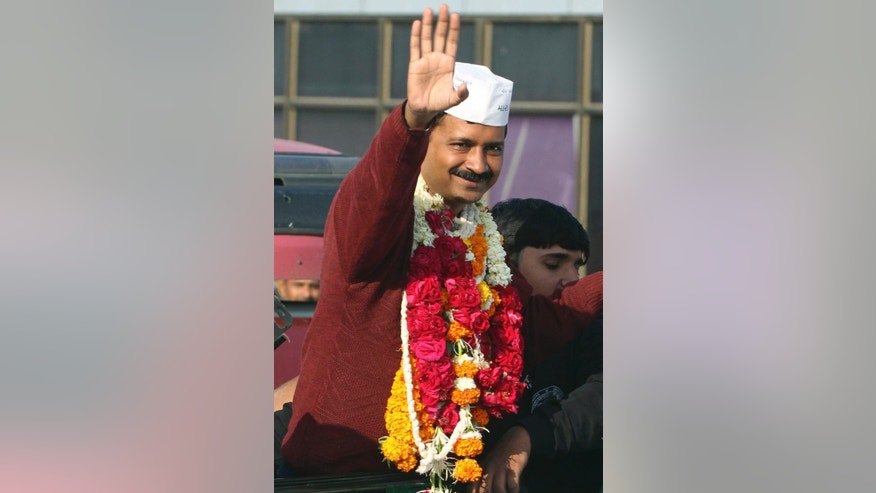 Anti-graft activist and leader of Aam Aadmi Party, or Common Man Party, Arvind Kejriwal waves to supporters upon his arrival for a four-day visit of Gujarat state ahead of the country's national elections, in Ahmadabad, India, Wednesday, March 5, 2014. India said Wednesday it will begin national elections on April 7, kicking off a month-long contest in the largest democracy in the world. More than 810 million people are eligible to vote this year, an increase of 100 million from five years ago, according to the Election Commission. (AP Photo/Ajit Solanki)