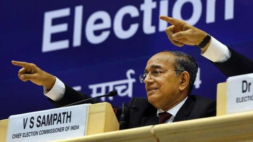 India's Chief Election Commissioner V.S. Sampath gestures during a press conference after announcing dates for the country's national elections in New Delhi, India, Wednesday, March 5, 2014. India said Wednesday it will begin national elections on April 7, kicking off a month-long contest in the largest democracy in the world. The election is held over several weeks for reasons of logistics and safety in a country of 1.2 billion. More than 810 million people are eligible to vote this year, an increase of 100 million from five years ago, according to the Election Commission. (AP Photo /Manish Swarup)