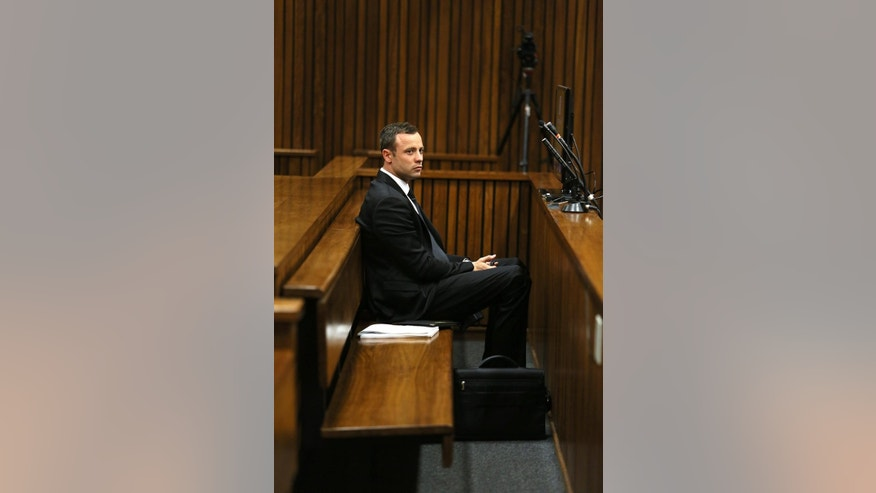 Oscar Pistorius sits in the dock on the third day of his trial at the high court in Pretoria, South Africa, Wednesday, March 5, 2014. Pistorius is charged with murder for the shooting death of his girlfriend, Reeva Steenkamp, on Valentines Day in 2013. (AP Photo/Alon Skuy, Pool)
