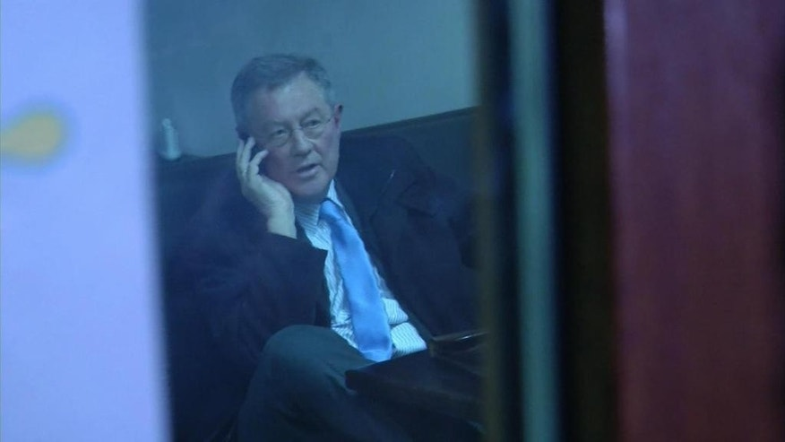 "This image taken from AP video shows Robert Serry sat in a cafe in Simferopol, Ukraine, as he makes a call on his mobile phone, Wednesday, March 5, 2014 as men in famouflage outfits stood outside. The special U.N. envoy who is visiting Crimea was threatened by 10 to 15 armed men on Wednesday and ordered to leave the region, where Ukraine and Russia are locked in a tense standoff, U.N. officials said. Later, an Associated Press reporter found Robert Serry in the business class lounge of the Simferopol airport on Wednesday evening. ""I'm safe. My visit was interrupted for reasons that I cannot understand,"" the Dutch diplomat said in a statement to AP. He said nothing more. (AP Photo/AP video)"
