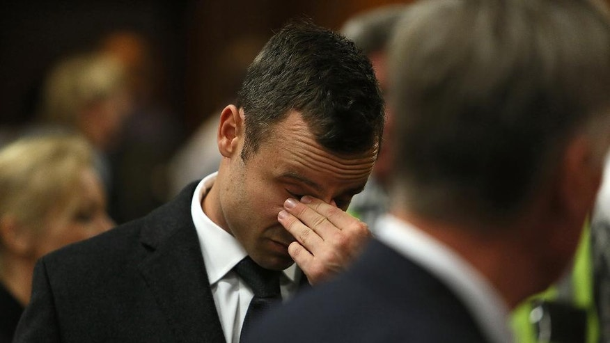 Oscar Pistorius in court on the third day of his trial at the high court in Pretoria, South Africa, Wednesday, March 5, 2014. Pistorius is charged with murder for the shooting death of his girlfriend, Reeva Steenkamp, on Valentines Day in 2013. (AP Photo/Alon Skuy, Pool)