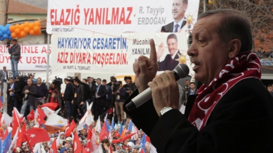 March 6, 2014: Turkish Prime Minister Recep Tayyip Erdogan addresses a rally of his Justice and Development Party in Elazig, Turkey. Turkey will hold nationwide municipality elections on March 30, 2014.