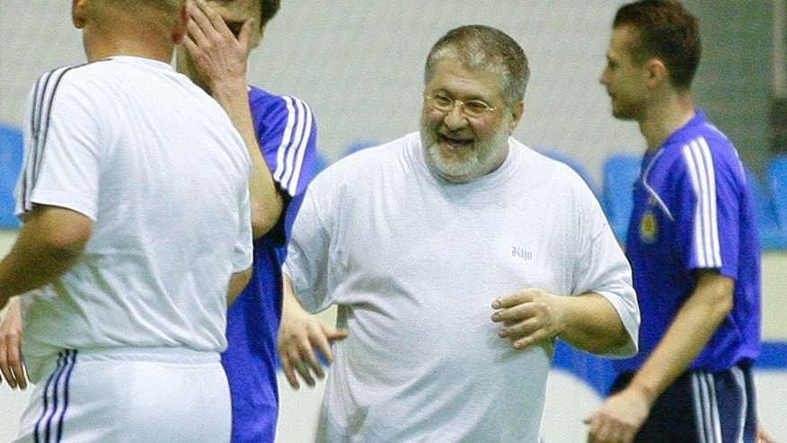 Feb. 26, 2010: Ukrainian oligarch Igor Kolomoyskiy, center, plays soccer in Kiev, Ukraine. For years, Ukraine's business tycoons have challenged the central authorities in Kiev, fighting, plotting and scheming to enlarge and maintain their multimillion-dollar empires. But when President Vladimir Putins troops invaded the pro-Russian strategic Black Sea peninsula of Crimea and held massive military exercises near the border with eastern Ukraine, the country's richest men put their rivalries aside, rallied behind the new government in Kiev and took up governors posts in the east of the country to counter possible Russian aggression there.  (AP/Andriy Lukatsky)