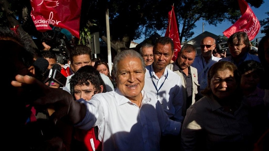 FILE - In this Feb. 2, 2014 file photo, Vice President Salvador Sanchez, presidential candidate for the ruling Farabundo Marti National Liberation Front (FMLN), greets supporters after voting at a polling station in San Salvador, El Salvador. Sanchez, a former guerrilla commander, is the favorite to win the second round presidential election Sunday, March 9, 2014. (AP Photo/Esteban Felix, File)