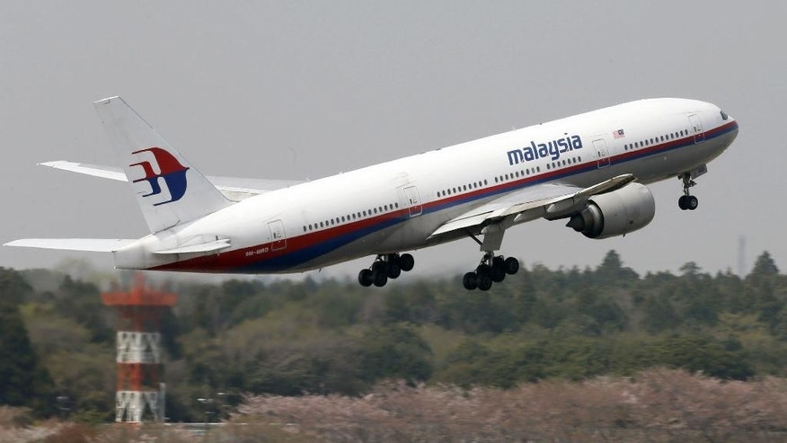 This photo taken in April, 2013, shows a Malaysia Airlines Boeing 777-200ER at Narita Airport in Narita, near Tokyo. A Malaysia Airlines Boeing 777-200 carrying 239 people lost contact with air traffic control early Saturday morning, March 8, 2014 on a flight from Kuala Lumpur to Beijing, and international aviation authorities still hadn't located the jetliner several hours later. (AP Photo/Kyodo News) JAPAN OUT, MANDATORY CREDIT