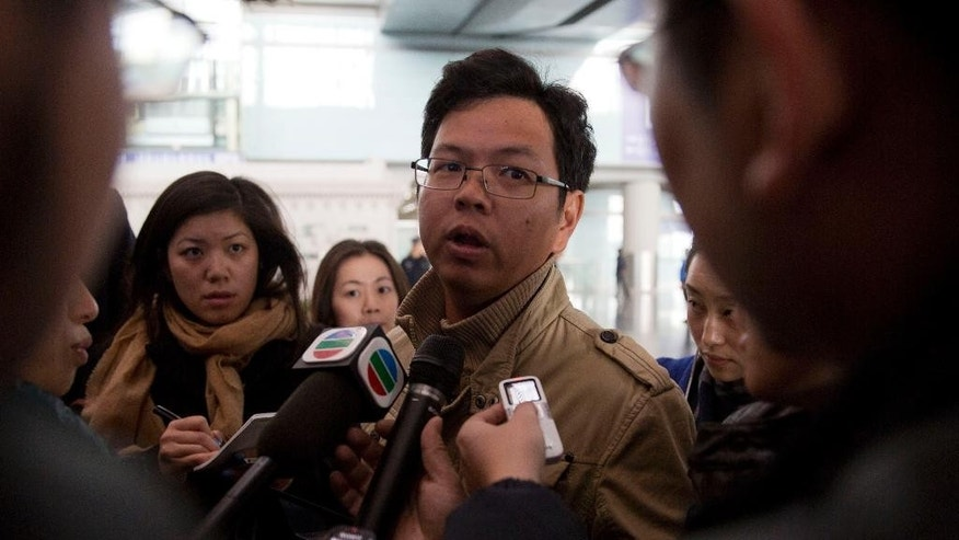 A Malaysian man who says he has relatives on board the missing Malaysian Airlines plane, talks to journalists at Beijing's International Airport Beijing, China, Saturday, March 8, 2014. A Malaysia Airlines Boeing 777-200 carrying 239 people lost contact with air traffic control early Saturday morning on a flight from Kuala Lumpur to Beijing, and international aviation authorities still hadn't located the jetliner several hours later. (AP Photo/Ng Han Guan)