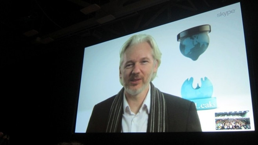 Mar. 8, 2014: Fugitive WikLeaks founder Julian Assange speaks via Skype at the South By SouthWest Interactive festival in Austin, Texas.