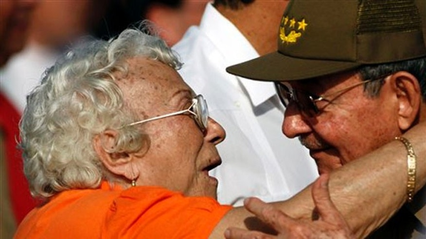 In this  July 26, 2010 file photo, Melba Hernandez, left, greets Cuba's President Raul Castro at a Revolution Day rally in Santa Clara, Cuba. Hernandez, who died on Sunday, March 9, 2014, helped found the Communist Party of Cuba and served as ambassador in Vietnam and Cambodia. She was 92.