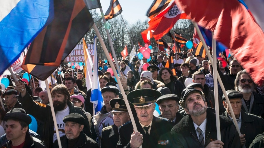 March 10, 2014 - About 1000 Patriotic demonstrators wave Russian national, navy and other patriotic flags as they gathered to support Russians in Crimea in Moscow, Russia.