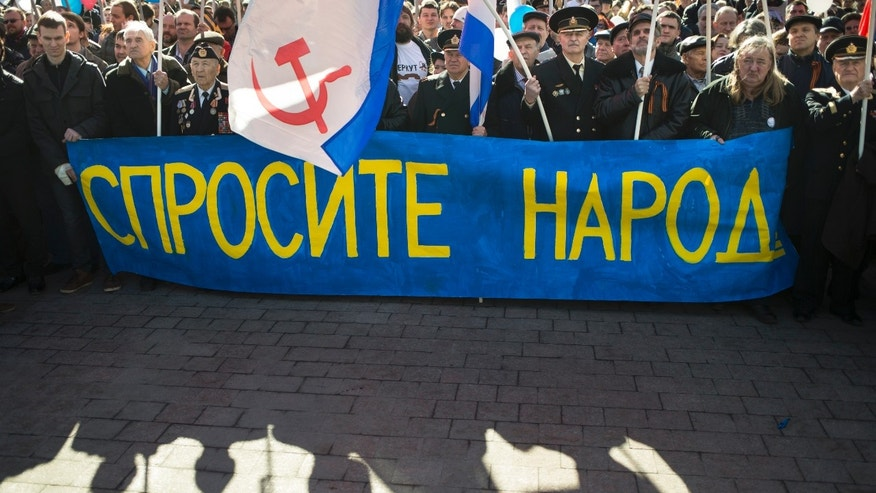 "March 10, 2014 - About 1,000 Patriotic demonstrators wave Russian national, navy and others patriotic's flags hold a banner reading "" Ask the people"" as they gathered to support Russians in Crimea in Moscow, Russia. A referendum has been called for Sunday on whether the region should split off and seek to become part of Russia."