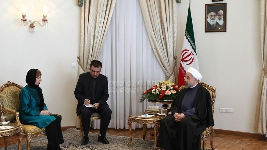 In this photo released by the official website of the office of the Iranian Presidency, Iran's President Hassan Rouhani, right, speaks with European Union's foreign policy chief Catherine Ashton, left, in Tehran, Iran, Sunday, March 9, 2014. Ashton said Sunday world powers talk with Iran will not necessary reach a final deal. An unidentified interpreter sits center. (AP Photo/Mohammad Berno, Iranian Presidency Office)