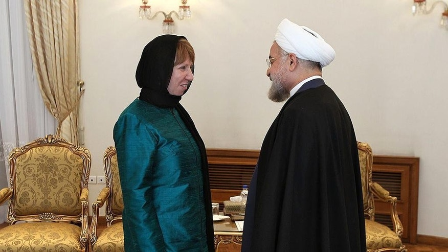 In this photo released by the official website of the office of the Iranian Presidency, Iran's President Hassan Rouhani, right, welcomes European Union's foreign policy chief Catherine Ashton for their meeting, in Tehran, Iran, Sunday, March 9, 2014. The European Union's foreign policy chief said Sunday world powers talk with Iran will not necessary reach a final deal. (AP Photo/Mohammad Berno, Iranian Presidency Office)