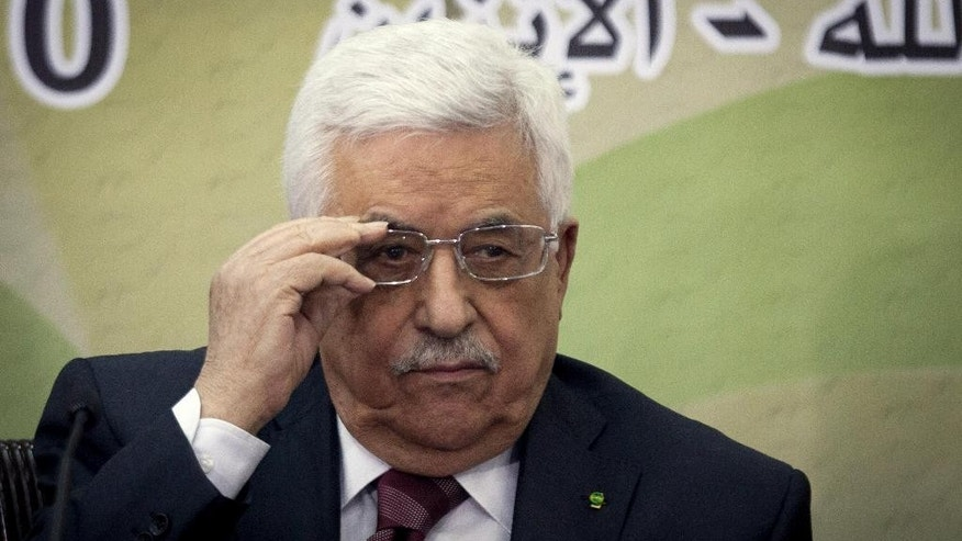 Palestinian President Mahmoud Abbas attends a meeting of the Fatah revolutionary council in the West Bank city of Ramallah, Monday, March 10, 2014. (AP Photo/Majdi Mohammed)