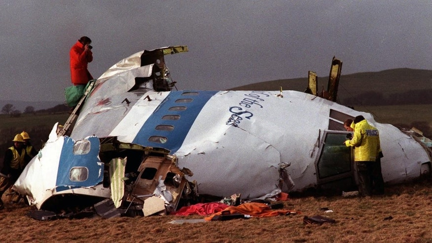 Police and investigators look at what remains of the flight deck of Pan Am 103 on a field in Lockerbie, Scotland in this Dec 22, 1988 file photo . (AP Photo/File)