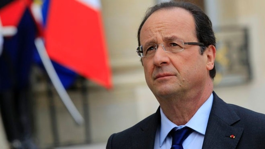 May 17, 2013: French President Francois Hollande reacts as he speaks to journalists in the courtyard after a meeting at the Elysee Palace in Paris.