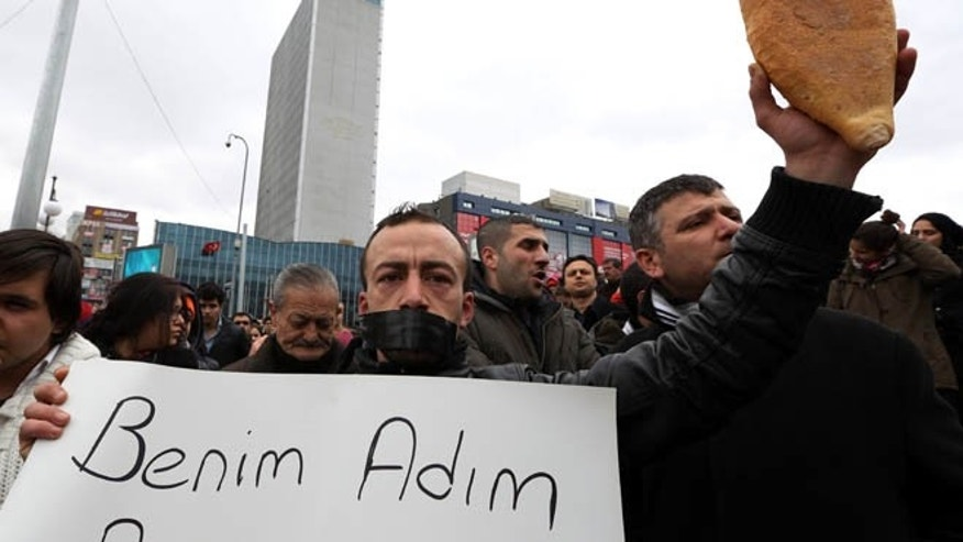 March 11, 2014: People gather to protest the death of Berkin Elvan, a Turkish teenager who was in a coma since being hit on the head by a tear gas canister fired by police during the last summer's anti-government protests, in Ankara, Turkey.