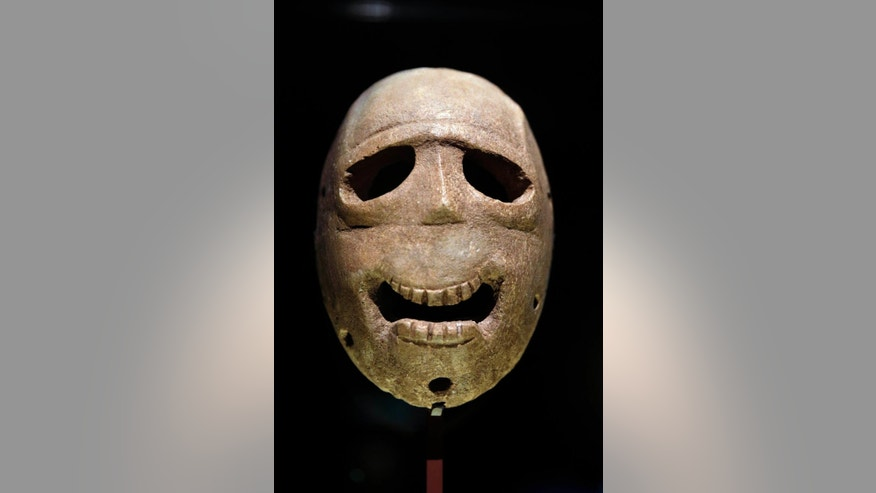 "In this  Monday, March 10, 2014 photo, a 9,000 year-old mask is on display at the Israel Museum in Jerusalem. The exhibition called ""Face To Face"" shows eleven stone masks, said to have been discovered in the Judean desert and hills near Jerusalem, which date back 9,000 years and offer a rare glimpse at some of civilization's first communal rituals. (AP Photo/Tsafrir Abayov)"