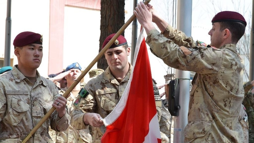 The army takes down the Canadian flag for the last time in Afghanistan bringing an end to 12 years of military involvement in a campaign, Wednesday March 12, 2014, in Kabul, Afghanistan. The war cost the lives of 158 soldiers, one diplomat, one journalist and two civilian contractors, according to The Canadian Press. (AP Photo/The Canadian Press, Murray Brewster)