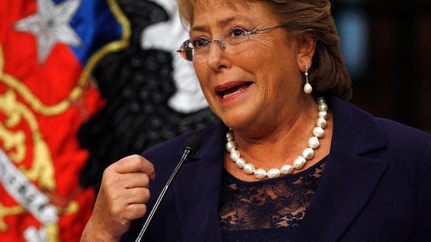 Chile's new President Michelle Bachelet sepaks at the presidential palace La Moneda in Santiago, Chile, Wednesday, March 12, 2014. Bachelet, who led Chile from 2006-2010, was sworn-in as president on Tuesday. (AP Photo/Luis Hidalgo)