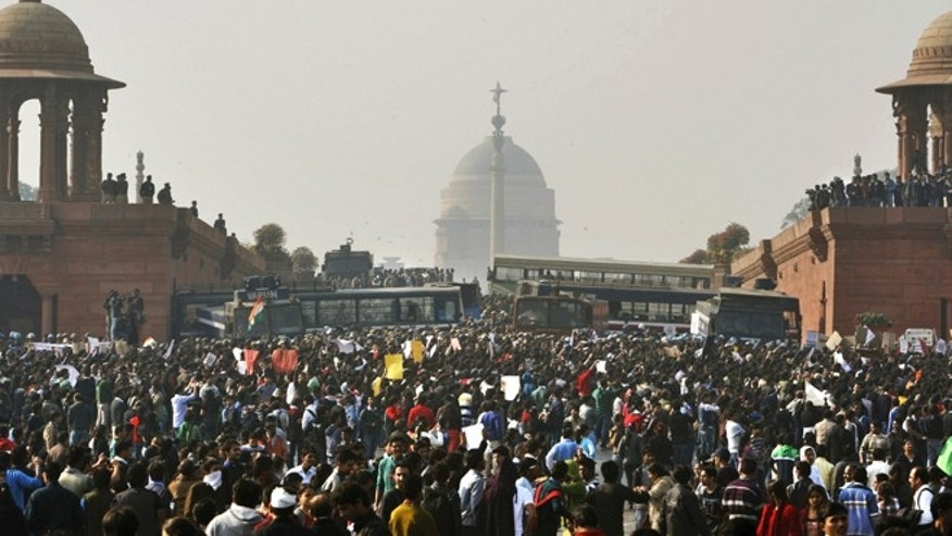 Dec. 22, 2012: In this file photo, protesters gather outside the Indian Presidential Palace during a rally against the gang rape and brutal beating of a 23-year-old student on a moving bus in New Delhi, India.