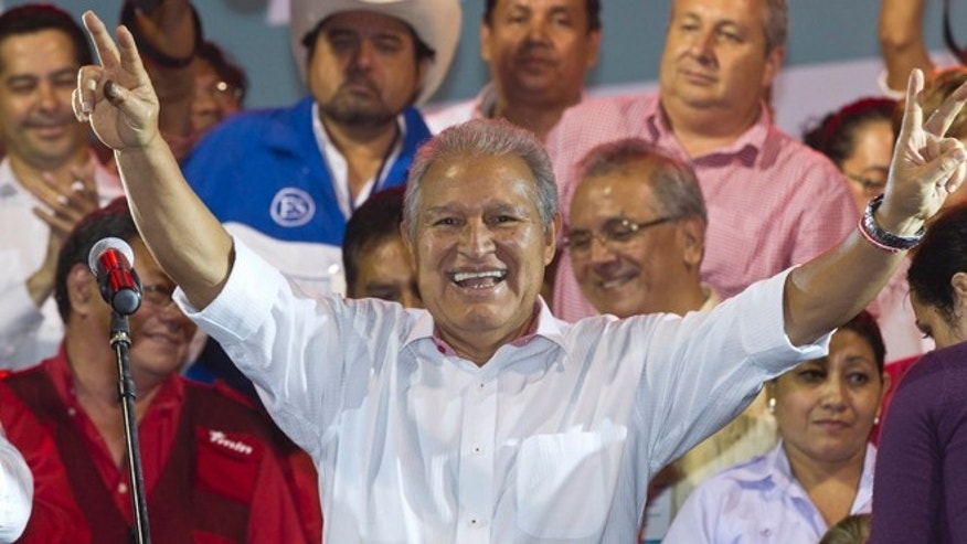 Mar. 9, 2014: Presidential candidate Salvador Sanchez Ceren, of the ruling Farabundo Marti National Liberation Front (FMLN), celebrates after partial results were announced by election authorities in San Salvador, El Salvador.