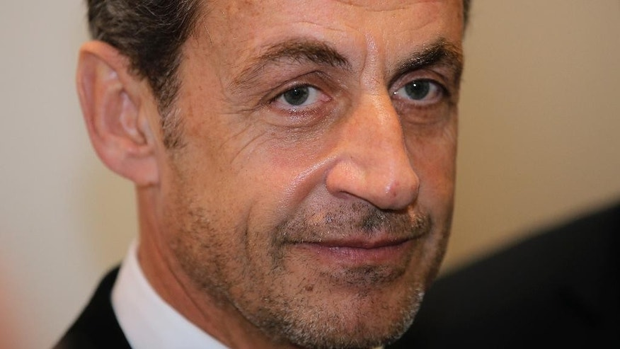 Former French President Nicolas Sarkozy attends the inauguration of the Foundation Claude Pompidou, Centre teaching and research on Alzheimer's disease, Monday, March 10, 2014. in Nice, southeastern France. The Foundation has focused on facilities designed for people suffering from Alzheimer's disease. Nicolas Sarkozy and his singer-songwriter wife Carla Bruni are asking a judge for an emergency injunction Monday March 10, 2014, barring any publication of private conversations secretly recorded by former aide Patrick Buisson.(AP Photo/Lionel Cironneau)