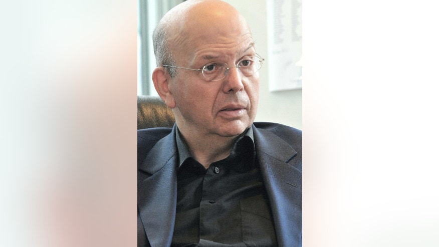 This June 9, 2009 photo shows Patrick Buisson, a former aide of President Nicolas Sarkozy, in his office outside Paris.  Former French President Nicolas Sarkozy and his singer-songwriter wife Carla Bruni are asking a judge for an emergency injunction Monday March 10, 2014, barring any publication of private conversations secretly recorded by former aide Patrick Buisson, also including discussions between Sarkozy and his inner circle. Buisson made the recordings, which his lawyer said were to help the aide keep accurate records. (AP Photo/Patrick Iafrate)