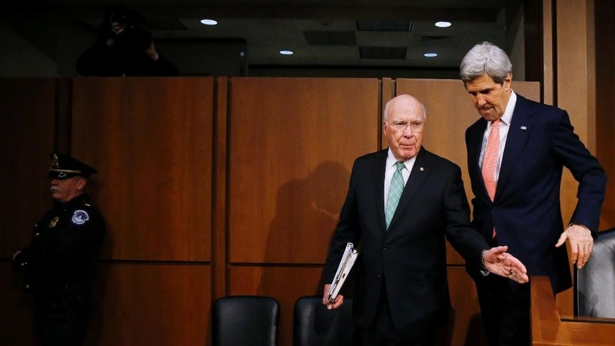 Secretary of State John Kerry walks with Sen. Patrick Leahy, D-Vt. on Capitol Hill in Washington, Thursday, March 13, 2014, prior to Kerry's testimony before the Senate Appropriations subcommittee on Foreign Operations and Related Programs hearing on the State Department's fiscal 2015 budget.  In his opening remarks Kerry spoke about Ukraine and other current foreign relation issues. (AP Photo/Charles Dharapak)