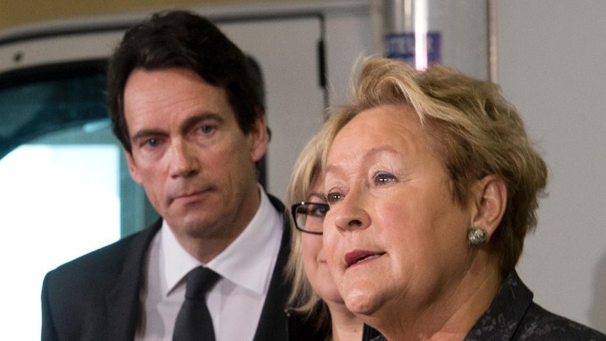 Parti Quebecois Leader Pauline Marois speaks at a news conference, while candidate Pierre Karl Peladeau, left, looks on, Thursday, March 13, 2014 in Levis. Quebecers are going to the polls on April 7.  (AP Photo/The Canadian Press, Jacques Boissinot)