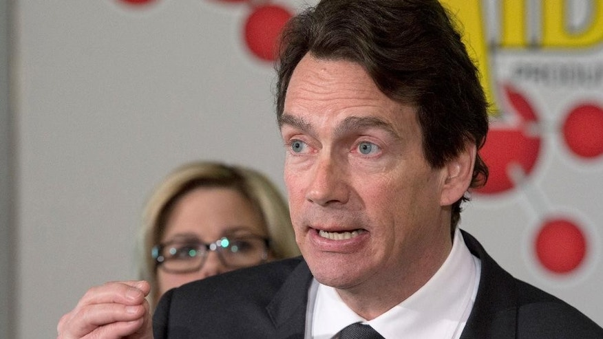 Parti Quebecois candidate Pierre Karl Peladeau speaks at a news conference, Thursday, March 13, 2014 in Levis. Quebecers are going to the polls on April 7.  (AP Photo/The Canadian Press, Jacques Boissinot)