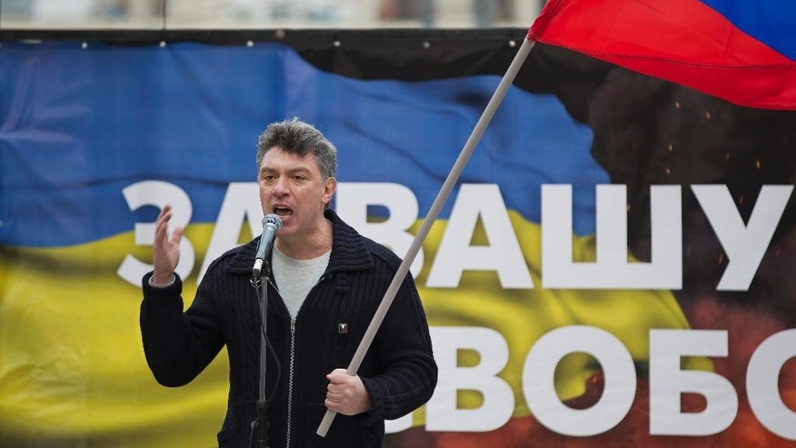 Boris Nemtsov, a former Russian deputy prime minister and opposition leader addresses demonstrators during a massive rally to oppose president Vladimir Putin's policies in Ukraine, in Moscow, Saturday, March 15, 2014. Large rival marches have taken place in Moscow over Kremlin-backed plans for Ukraine's province of Crimea to break away and merge with Russia. More than 10,000 people turned out Saturday for a rally in the center of the city held to oppose what many demonstrators described as Russia's invasion of the Crimean Peninsula. In a nearby location, a similar sized crowd voiced its support for Crimea's ethnic Russian majority, who Moscow insists is at threat from an aggressively nationalist leadership now running Ukraine. (AP Photo/Alexander Zemlianichenko) (AP Photo/Alexander Zemlianichenko)