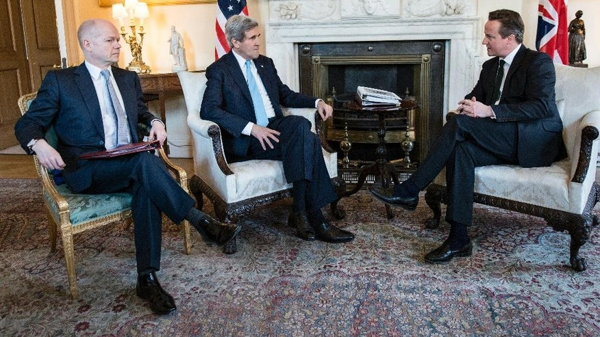 Britain's Prime Minister David Cameron, right, and Foreign Secretary William Hague, left, meet with US Secretary of State John Kerry in Downing Street, central London, Friday March 14, 2014. U.S. Secretary of State John Kerry flew to London on Friday to meet with Russian Foreign Minister Sergey Lavrov in a last-minute bid to stave off a new chapter in the East-West crisis over Ukraine. (AP Photo/Brendan Smialowski, Pool)
