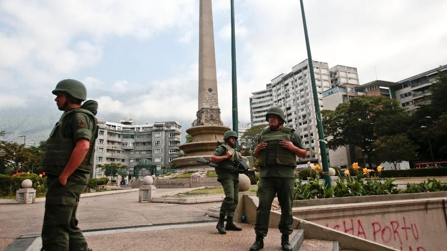 Bolivarian National Guard officers patrol Plaza Altamira after taking control of it, in Caracas, Venezuela, Monday, March 17, 2014. Government security forces took control of a Caracas plaza and surrounding neighborhoods Monday morning that had become the center of student-led protests. Clusters of National Guardsmen were a visible presence not only on Plaza Altamira, but along the principal streets extending from it in the municipality of Chacao. (AP Photo/Esteban Felix)