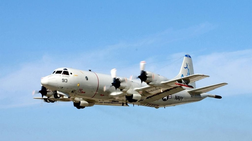 FILE - This Jan. 2003 file photo provided by the U.S. Navy shows a P-3 Orion shortly after takeoff from Naval Air Station North Island, Calif.  The U.S. Navy decided that long-range naval aircraft were a more efficient way to search for missing Malaysia Airlines Boeing 777 in such a vast area, so will be relying on P-3 and P-8 planes, while the two destroyers go back to normal duties. (AP Photo/US Navy, Mahlon K. Miller, File)