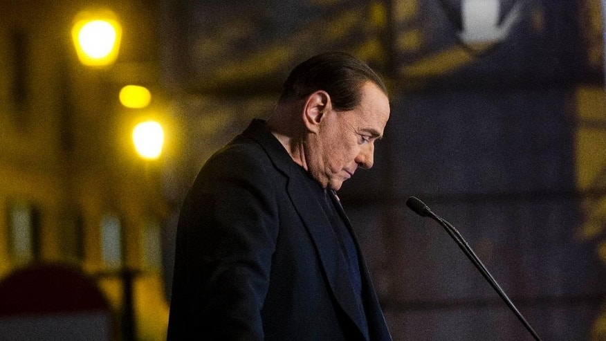 In this Wednesday, Nov. 27, 2013 file photo Silvio Berlusconi pauses during a rally in Rome. Italy's highest court has upheld a two-year political ban against Silvio Berlusconi stemming from his tax fraud conviction. The Court of Cassation ruling handed down late Tuesday, March 19, 2014 is the latest setback for Berlusconi, who was kicked out of Parliament last year after the high court upheld his conviction and four-year prison sentence. Despite the ban on holding or running for public office, Berlusconi remains a force in Italian politics, heading his Forza Italia party. (AP Photo/Alessandra Tarantino, File)