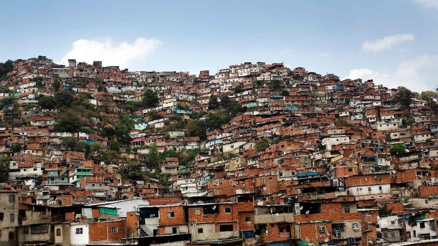 In this March 6, 2014 photo, a hill covered with low income houses is seen in Petare district, Caracas, Venezuela. There is plenty of discontent among the lower classes but the students have failed to capitalize on it.  But Venezuela's poor are, on the whole, more worried about losing the pensions, subsidisies, education and health services gained under Chavez if the opposition were to come to power. (AP Photo/Rodrigo Abd)