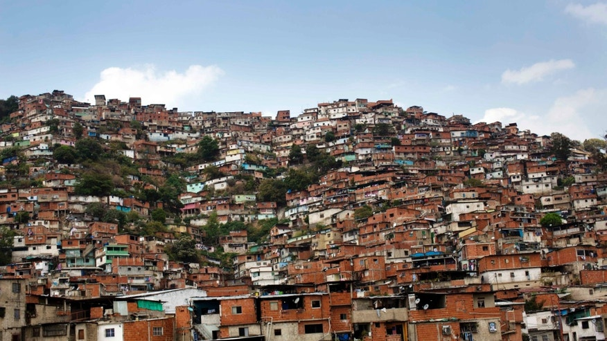 A hill covered with low income houses is seen in Petare district, Caracas, Venezuela.