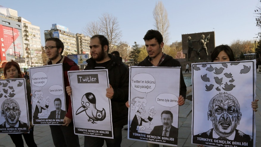 "March 21, 2014 - Members of the Turkish Youth Union hold cartoons depicting Turkey's Prime Minister Recep Tayyip Erdogan during a protest against a ban on Twitter. (Cartoon 2nd right reads: Erdogan, left, to his Ankara Mayor Melih Gokcek  ""we will rip out the roots of Twitter,""  Gokcek says:  ""Don't say it."""