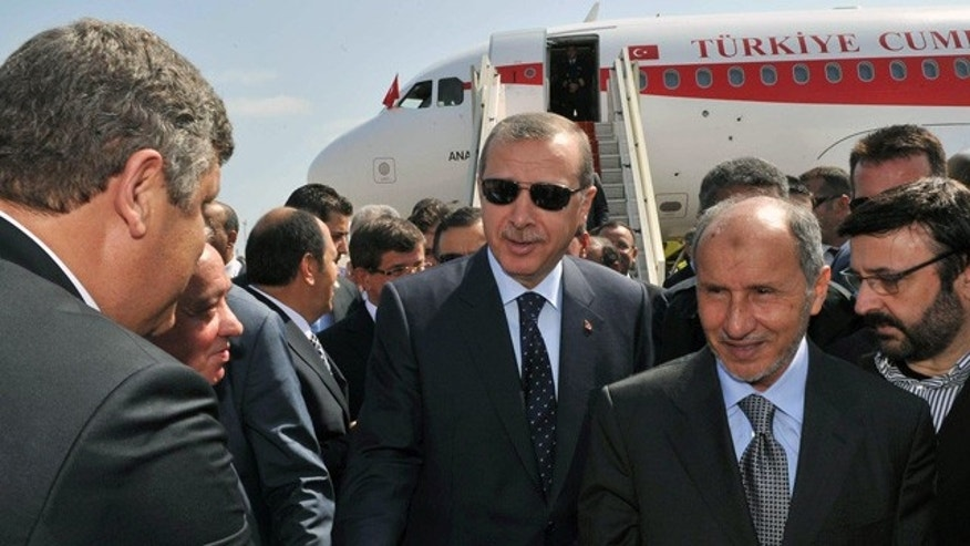 Sept. 16: Prime Minister Recep Tayyip Erdogan, center, arrvies at Tripoli Airport, Libya.